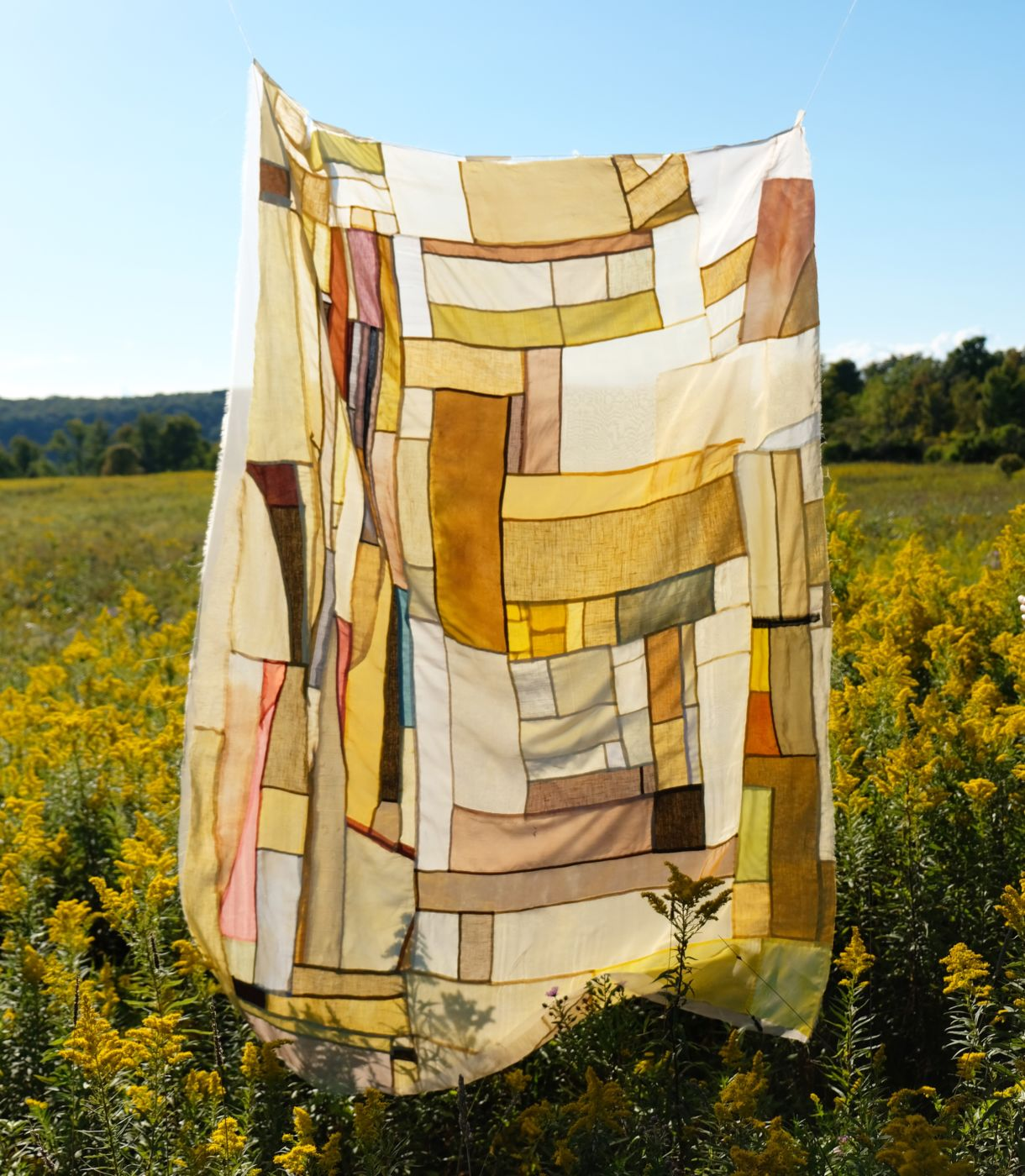 Handmade botanically dyed quilt using goldenrod, turmeric, onion, and sumac. Quilt, dyes, and photo by Kiva Motnyk of Thompson Street Studio.